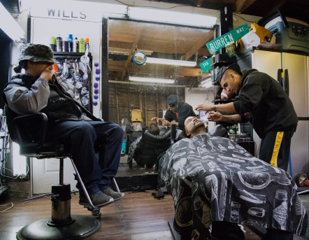 Jason lining up his clients beard while his friend observes. Photo by Randy Vazquez.