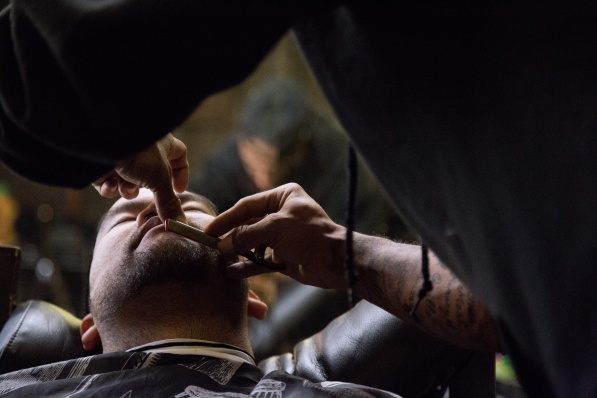 Jason Jerk putting the finishing touches on a haircut. Photo by Randy Vazquez