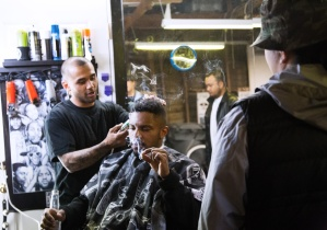 Jason finishing his last clients haircut before calling it a night. Photo by Randy Vazquez.