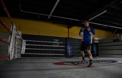 Kenneth shadow boxing for the first time since his accident. An accomplishment since two months ago he barely was able to walk on his own. Photo by Randy Vazquez