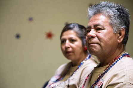 Gilberto Martinez stares sits alongside his wife Consuelo Martinez as they wait for their son Marco Martinez. Photo by Randy Vazquez.