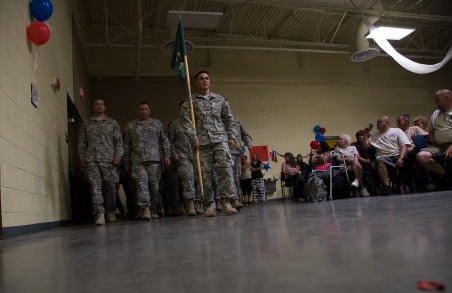 The returning soldiers enter the hall where they are greeted by friends and family. Photo by Randy Vazquez.