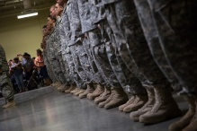 The soldiers line-up and listen to a speech by their unit leader. Photo by Randy Vazquez.