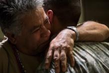 Gilberto Martinez hugs his son Marco Martinez. Photo by Randy Vazquez.