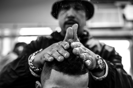"""San Jose Calif. Barber Mark Zant styles his clients hair into a """"faux hawk"""". After spending 25 years of his life in prison, Zant uses his barbering craft to give back to the community by often giving cuts to the homeless that dot the landscape of Downtown San Jose. Randy Vazquez"""