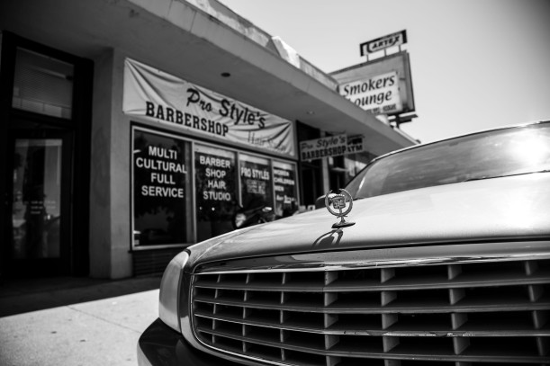 """A Cadillac Deville parked in front of """"Pro Style's"""" barbershop in San Jose, Calif. (Randy Vazquez)"""