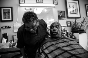 Belinda Bush, left, consults her client prior to providing a barbering service. Bush is a barber out of Campbell, Calif. and has over 25 years of barbering experience. (Randy Vazquez)