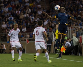 LA Galaxy forward Gyasi Zardes soars over a pair of San Jose Earthquakes defenders during the Galaxy's 3-1 loss on June 27, 2015 at Stanford Stadium in Palo Alto, Calif. (Randy Vazquez)