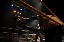 """Hoodslam"" wrestlers Marty McFlux drop kicks F'n Obese Nerdy Gamer during their match on March 6, 2015 in Oakland, Calif. McFlux would go on to win the match. (Randy Vazquez)"