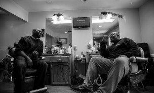 """Michael Sanders, left, and Bryan Lane, right, own and operate """"Da Barbershop"""" in San Jose, Calif. The pair have a combined 43 years of barber experience. Randy Vazquez"""