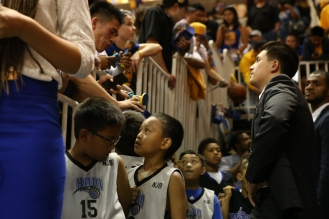 Members of the Berryessa and Milpitas National Junior Basketball team line up alongside the entrance of the locker room as they wait for the Golden State Warriors to come out during the Warriors preseason opening game versus the Toronto Raptors on Oct. 5, 2015 at SAP Center in San Jose, Calif. (Randy Vazquez)