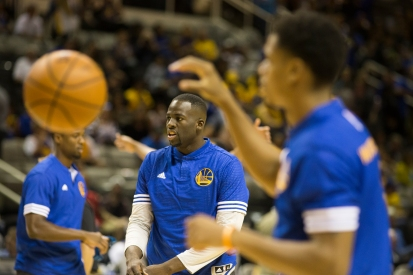 Golden State Warriors power forward Draymond Green warms up prior to his team's preseason opening game on Oct. 5, 2015 versus the Toronto Raptors at SAP Center in San Jose, Calif. Green would go on to lead his team in rebounds with six in the Warriors 95-87 win. (Randy Vazquez)