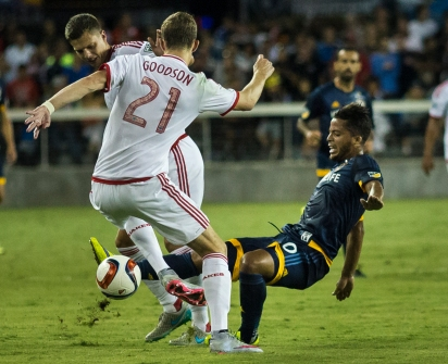 LA Galaxy forward Giovani dos Santos is brought down by San Jose Earthquakes defenders during the Galaxy's 1-0 loss on Aug. 10, 2015 at Avaya Stadium in San Jose, Calif. (Randy Vazquez)
