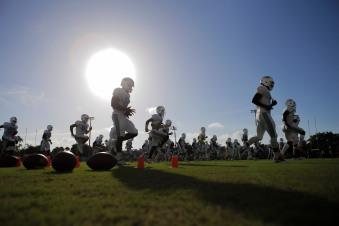 Miami Dolphins players warm up during training camp in Davie on Aug. 5, 2016. Randy Vazquez, Sun Sentinel