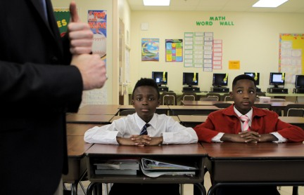 Some students at Forest Park Elementary in Boynton Beach are learning to be gracious young men during the Gentleman's Club, which meets after school every other Tuesday. Charles Brooks Hurte, left, and Zoe Augustin, right, listen to fifth grade teacher Michael Webber speak. Randy Vazquez, Sun-Sentinel