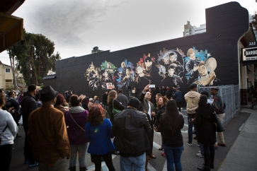"""Several dozen people showed up for the unveiling of the """"Interview with an Icon"""" mural on Dec. 2, 2015 in San Jose, Calif. (Randy Vazquez)"""