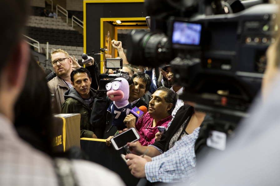 Media members from around the world crammed in tight pockets to ask players football questions and novelty questions during NFL Opening Night at SAP Center in San Jose, Calif. on Feb. 1, 2016. (Randy Vazquez)
