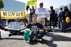 Protesters create a human blockade on Bayshore Hwy to prevent Donald Trump's caravan from entering the Hyatt Regency San Francisco Airport Hotel in Burlingame, Calif. on April 29, 2016. (Randy Vazquez)