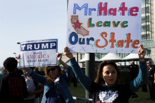 A lone Donald Trump supporter endorses the GOP front-runner in a sea of protesters at the GOP Convention in Burlingame, Calif. on April 29, 2016. (Randy Vazquez)