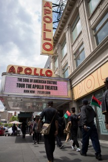 """Supporters during the """"Shut'em Down"""" Black Power March walk past the legendary Apollo Theater in Harlem, N.Y. on May 19, 2016. (Randy Vazquez)"""