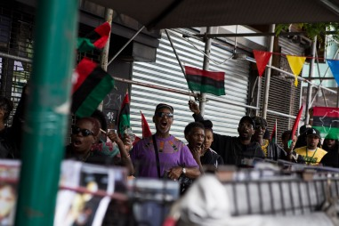 """Supporters during the """"Shut'em Down"""" Black Power March encourage vendors to honor the three-hour long economic boycott on May 19, 2016 in Harlem, N.Y. (Randy Vazquez)"""