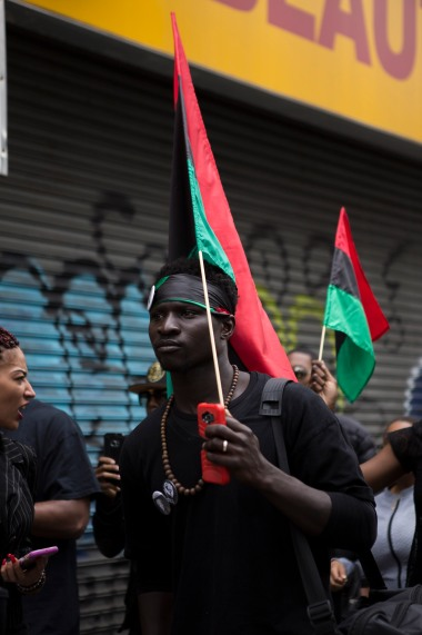 """Supporter carries his Pan-African flag during the """"Shut'em Down"""" Black Power March on May 19, 2016 in Harlem, N.Y. (Randy Vazquez)"""