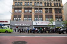 """Malcolm X day was first recognized in Berkeley, Calif. in 1979 but has now been recognized by many cities across the country. Supporters of the """"Shut'em Down"""" Black Power March walk down 125th Street in Harlem, N.Y. on May 19, 2016. (Randy Vazquez)"""
