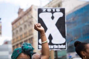 """This is the 27th annual """"Shut'em Down"""" Black Power March. The march is a three-hour economic boycott that honors civil rights activist Malcolm X on his birthday on May 19 in Harlem, N.Y. (Randy Vazquez)"""