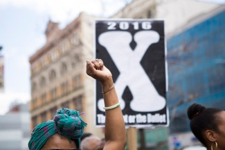 "This is the 27th annual ""Shut'em Down"" Black Power March. The march is a three-hour economic boycott that honors civil rights activist Malcolm X on his birthday on May 19 in Harlem, N.Y. (Randy Vazquez)"