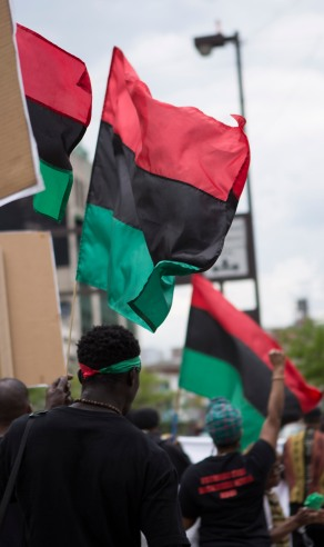 """Stores and vendors located on 125th Street between St. Nicholas Avenue and Fifth Avenue in Harlem, N.Y. were encouraged to stop operations from 1 p.m. to 4 p.m. on May 19, 2016 during the """"Shut'em Down"""" Black Power March. (Randy Vazquez)"""