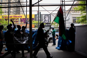 """Hundreds of supporters marched down 125th street in Harlem, N.Y. during the """"Shut'em Down"""" Black Power March on May 19, 2016. May 19 also marks human rights activist Malcolm X's 91st birthday. (Randy Vazquez)"""
