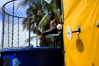People try to dunk fellow of attendees of the July 4th Celebration at Delray Beach on Monday.The event featured live music, family activities, and competitive eating. Randy Vazquez, Sun Sentinel