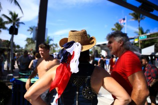 People decorate themselves in the colors of the American flag during the July 4th Celebration at Delray Beach on Monday.The event featured live music, family activities, and competitive eating. Randy Vazquez, Sun Sentinel