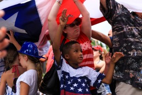 Thousands of people took part in the July 4th Celebration at Delray Beach on Monday.The event featured live music, family activities, and competitive eating. People at the event helped raise a large flag. Randy Vazquez, Sun Sentinel