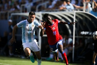 Woodensky Cherefant of Haiti, right, and Lisandro Magallan of Argentina, left, during a friendly between the two nations at Florida Atlantic University Stadium on Sunday, July 24, 2016. Argentina would go on to win 3-1. For Argentina the friendly will serve as preparation for the Olympics in Rio next month. Randy Vazquez, Sun Sentinel