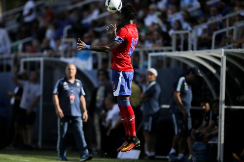 Woodensky Cherefant of Haiti jumps high to reach a ball during a friendly versus Argentina at Florida Atlantic University Stadium on Sunday, July 24, 2016. Argentina would go on to win 3-1. Randy Vazquez, Sun Sentinel