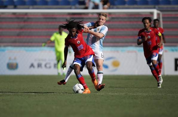 Junior Delva of Haiti fends off a defender during a friendly versus Argentina at Florida Atlantic University Stadium on Sunday, July 24, 2016. Argentina would go on to win 3-1. Randy Vazquez, Sun Sentinel