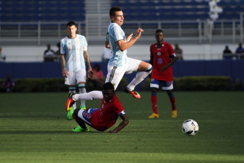 Mauricio Martinez of Argentina leaps over a defender during a friendly versus Haiti at Florida Atlantic University Stadium on Sunday, July 24, 2016. Argentina would go on to win 3-1. Randy Vazquez, Sun Sentinel