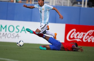Jose Luis Gomez of Argentina is taken down by a defender during a friendly versus Haiti at Florida Atlantic University Stadium on Sunday, July 24, 2016. Argentina would go on to win 3-1. Randy Vazquez, Sun Sentinel