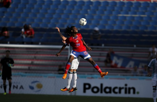 Junior Delva of Haiti jumps over defender to gain possession of the ball during a friendly versus Argentina at Florida Atlantic University Stadium on Sunday, July 24, 2016. Argentina would go on to win 3-1. Randy Vazquez, Sun Sentinel