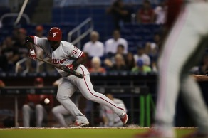 Odubel Herreraof the Philadelphia Phillies bunts the ball during his teams loss to the Miami Marlins on Wednesday, July 26, 2016. The Marlins would go on to win the game 11-1 over the Phillies .Randy Vazquez, Sun Sentinel