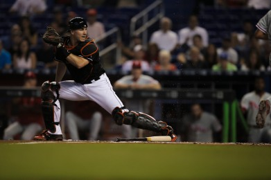 Catcher J.T. Realmuto of the Miami Marlins toe taps the plate to get a batter out on on Wednesday, July 26, 2016. The Marlins would go on to win the game 11-1 over the Phillies .Randy Vazquez, Sun Sentinel