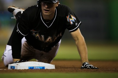 Don Kelly of the Miami Marlins slides into third base Wednesday, July 26, 2016. The Marlins would go on to win the game 11-1 over the Phillies .Randy Vazquez, Sun Sentinel