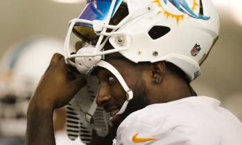 Wide receiver Jarvis Landry (14) puts on his helmet during Miami Dolphins training camp in Davie on Aug. 2, 2016. Randy Vazquez, Sun Sentinel