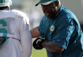 Running backs coach Danny Barrett tries to punch the ball out of players hands during Miami Dolphins training camp in Davie on Aug. 5, 2016. Randy Vazquez, Sun Sentinel