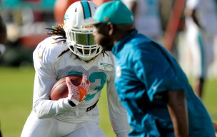 Running back Jay Ajayi (23) runs a drill during Miami Dolphins training camp in Davie on Aug. 5, 2016. Randy Vazquez, Sun Sentinel