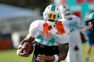 Running back Arian Foster (34) runs a drill during Miami Dolphins training camp in Davie on Aug. 5, 2016. Randy Vazquez, Sun Sentinel
