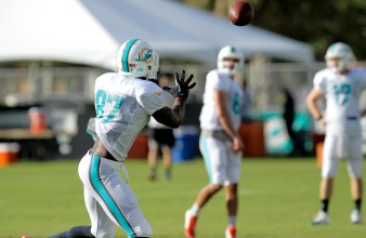 Wide receiver Rashawn Scott (87) catches a pass during Miami Dolphins training camp in Davie on Aug. 5, 2016. Randy Vazquez, Sun Sentinel