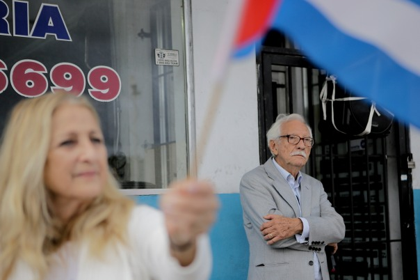 Zenen Perez Yera, right, looks on at the crown of people who gathered to celebrate the death of Fidel Castro on Nov. 26, 2016. Randy Vazquez, Sun-Sentinel