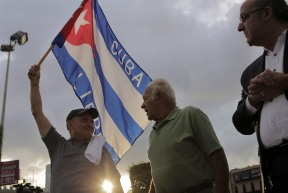 Hernan Reyes, left, speaks to Oreste Cervantes, center, on Eight Street in Little Havana on Nov. 26, 2016. Reyes and Cervantes joined the crowd of people celebrating the death of Fidel Castro. Randy Vazquez, Sun-Sentinel
